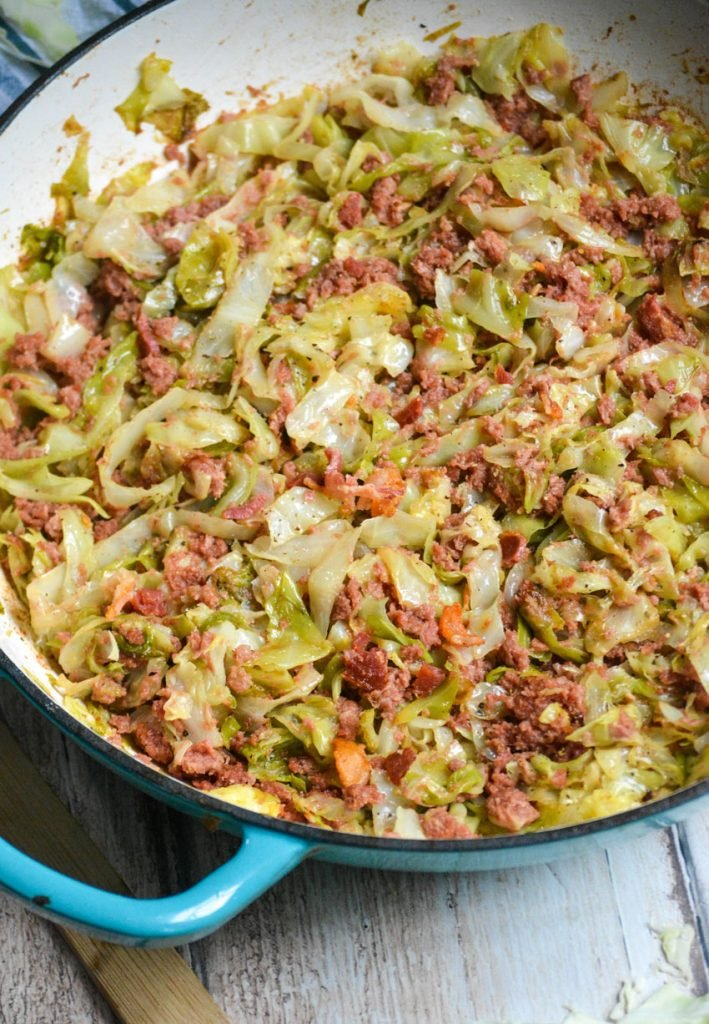 corned beef and cabbage skillet served in a light blue skillet