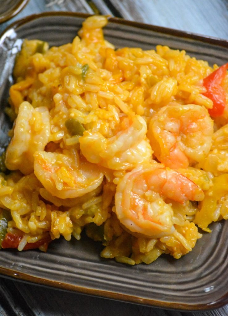 shrimp & rice casserole served on two small brown plates