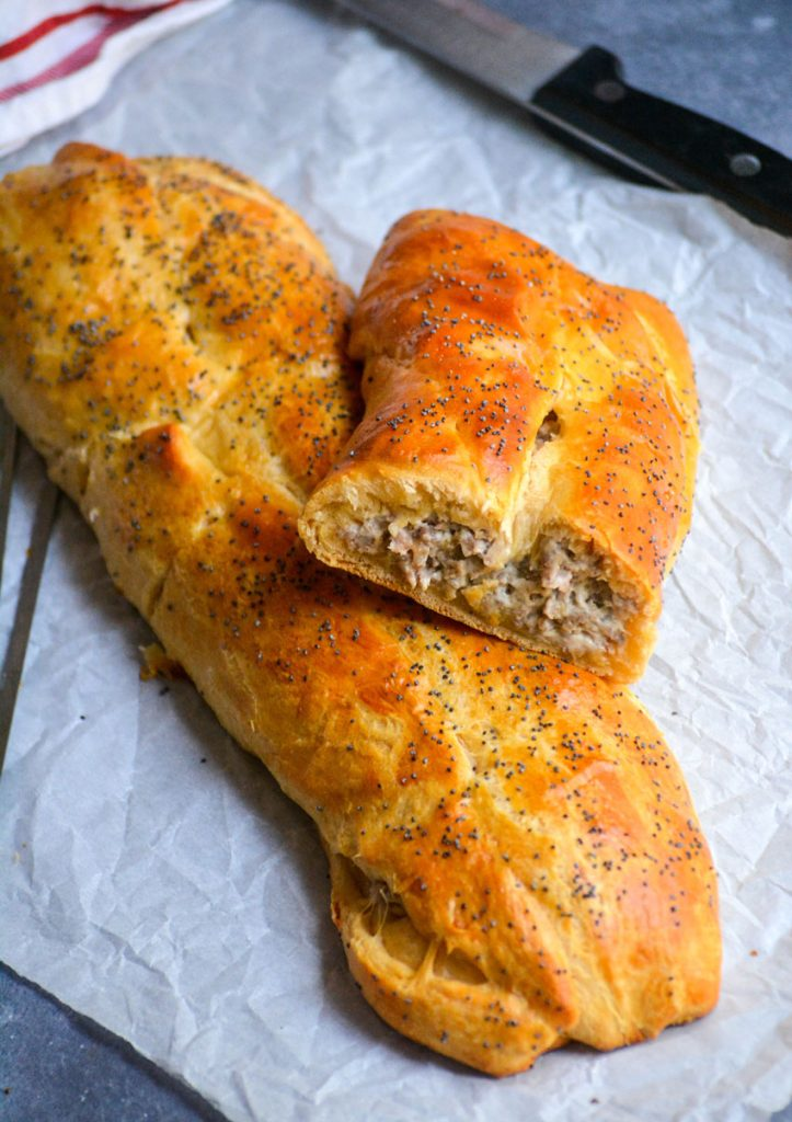 a classic sausage roll cut open to reveal the filling inside
