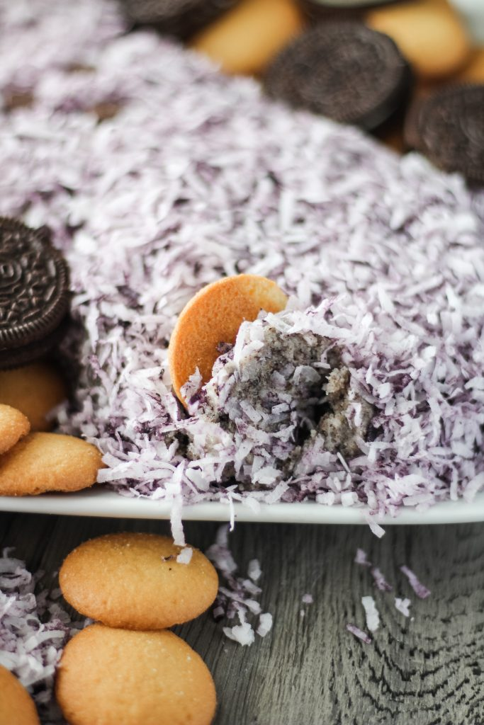 a vanilla wafer topped with cookies and cream cheese ball