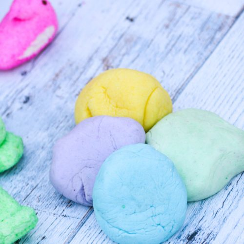 4 different colored balls of Peeps playdough shown together