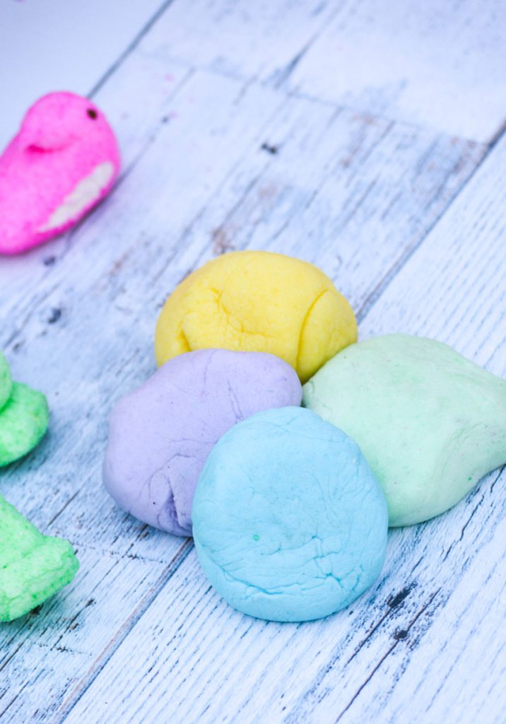 4 different colored balls of three ingredient edible Peeps playdough shown together