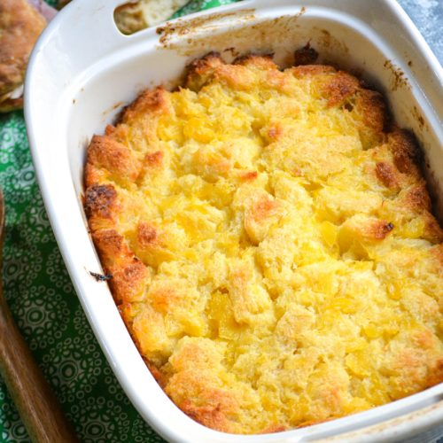 baked scalloped pineapple in a white casserole dish