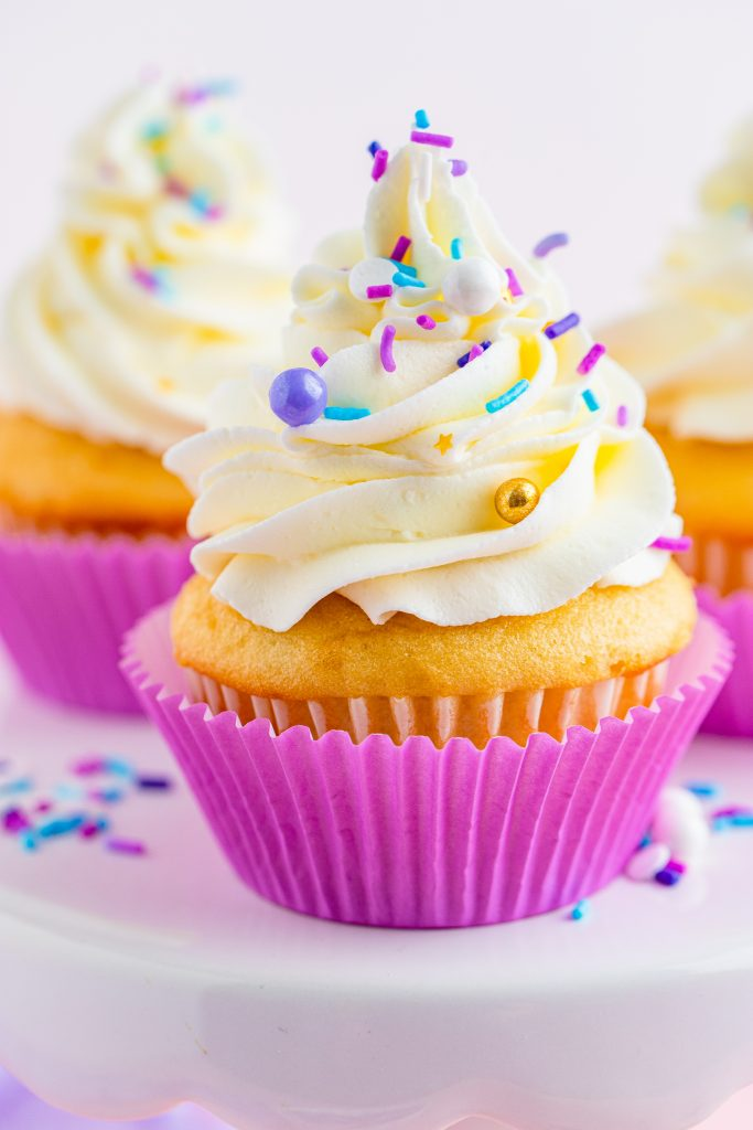 cupcakes piled high with swirls of fluffy cake decorating frosting