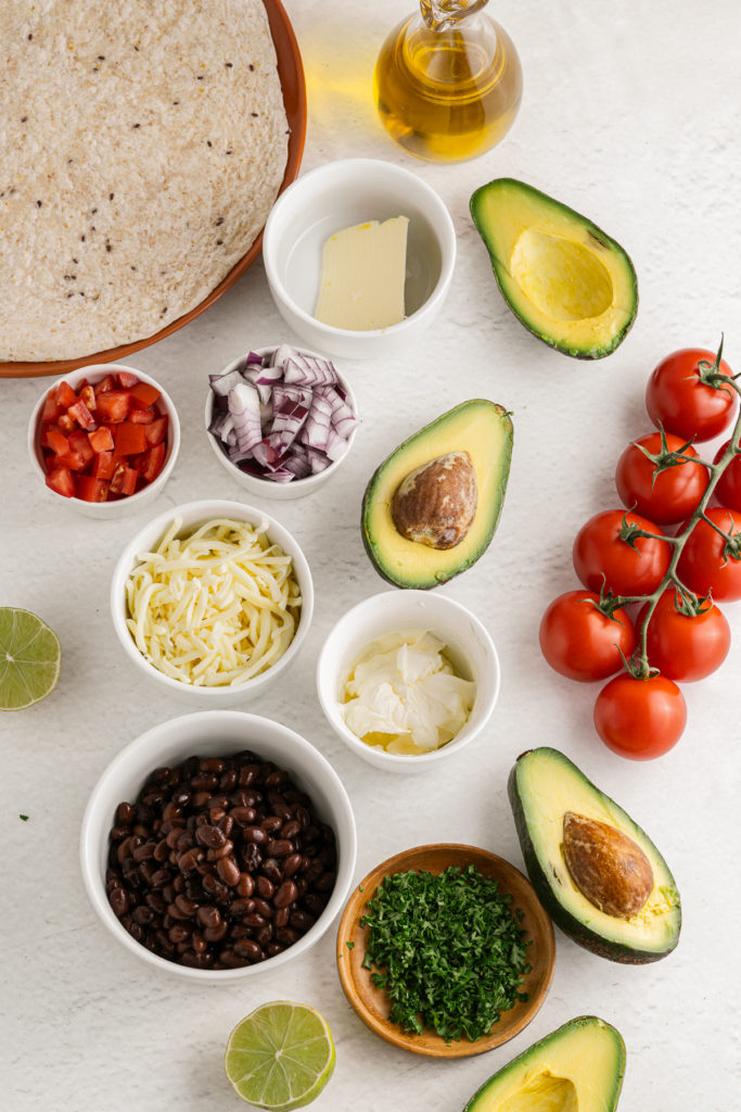 an overhead shot of the ingredients assembled to make vegetarian quesadillas