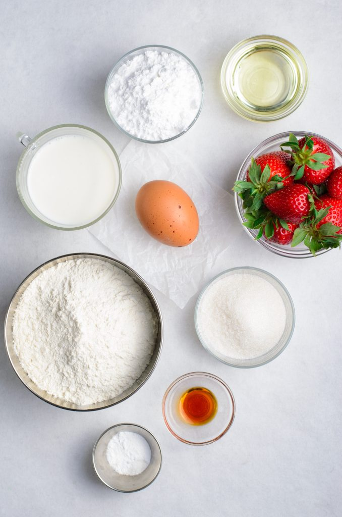 overhead show showing the ingredients needed for a batch of strawberry glazed donuts