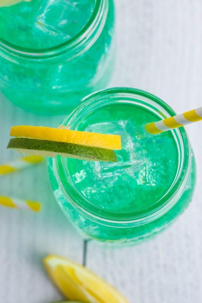 a closeup shot into the mouth of a glass mason jar filled with copycat baja blast soda