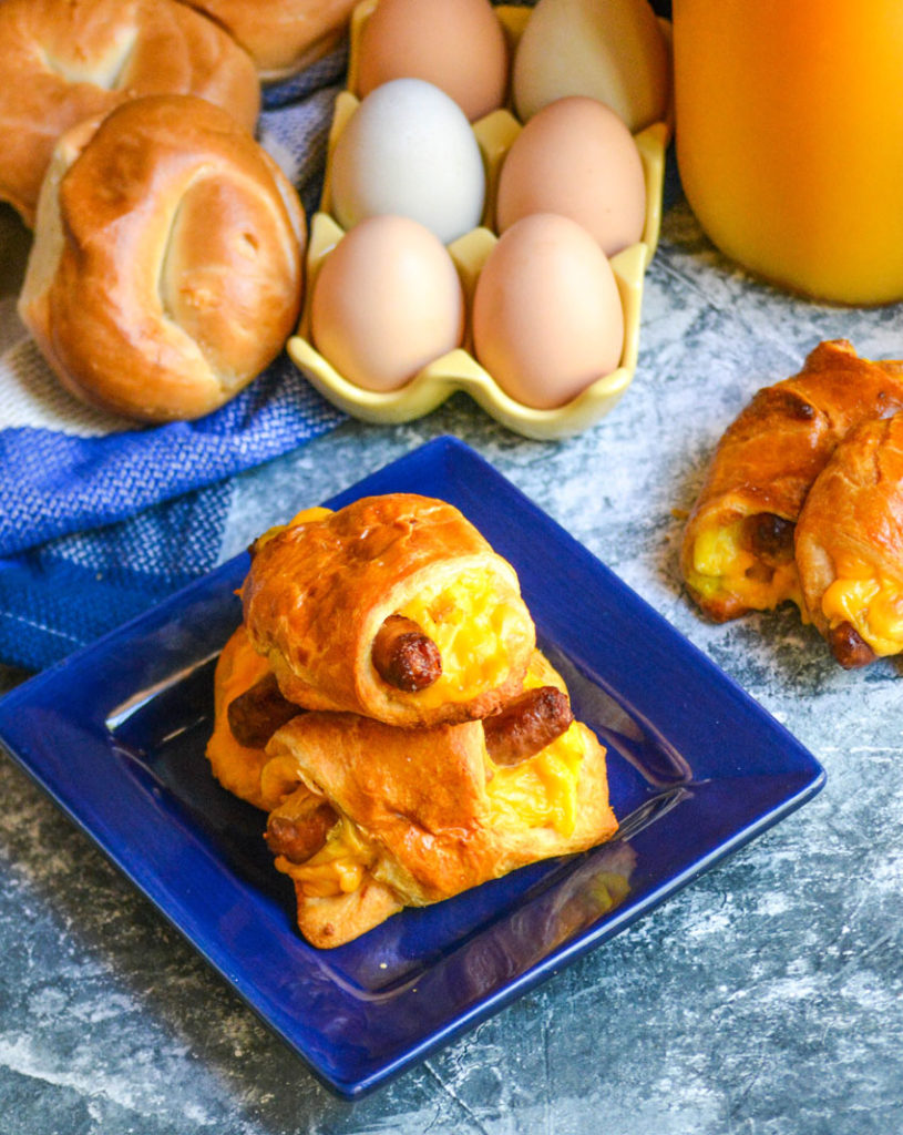 sausage egg and cheese breakfast rolls shown served on a square blue plate