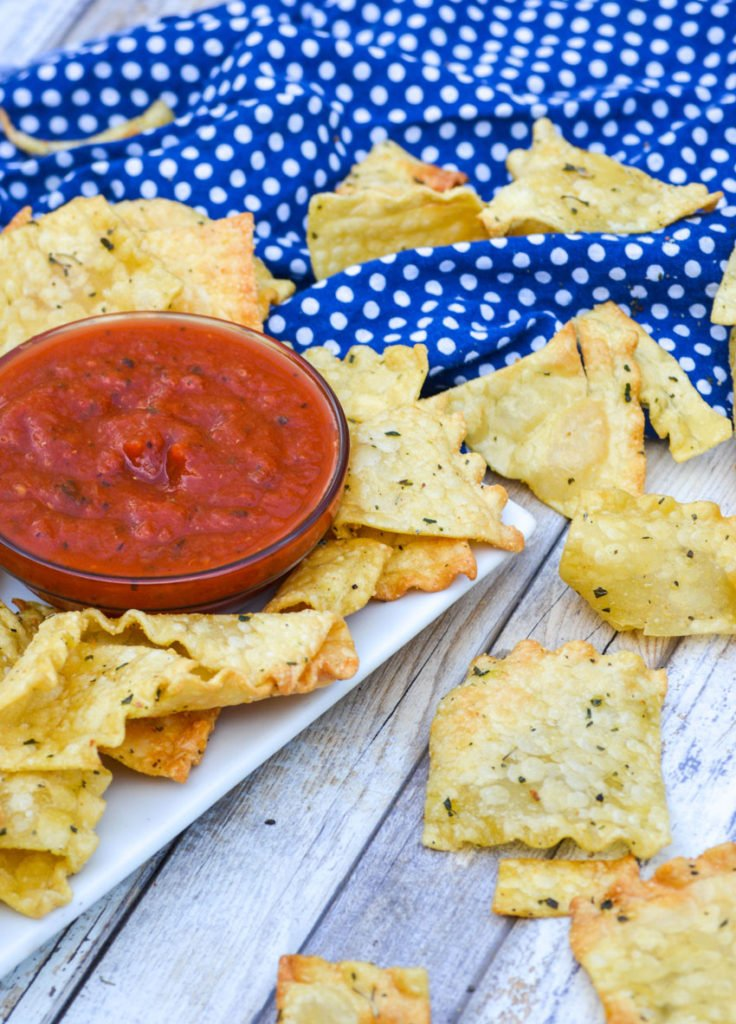 air fryer lasagna pasta chips served on a white platter with a small glass bowl filled with bright red marinara sauce
