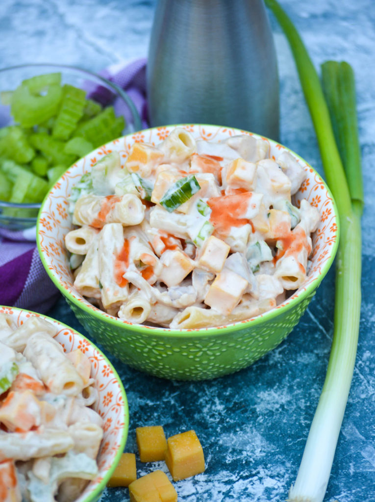 buffalo chicken pasta salad shown served in a small green bowl