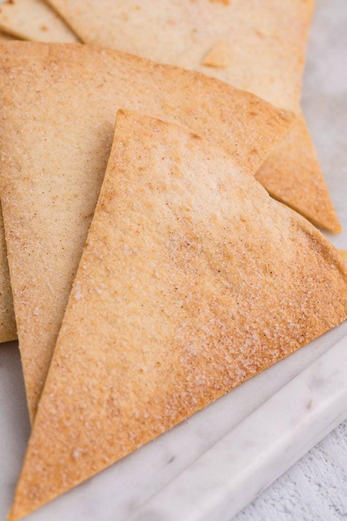 cinnamon sugar tortilla chips shown on a marble platter
