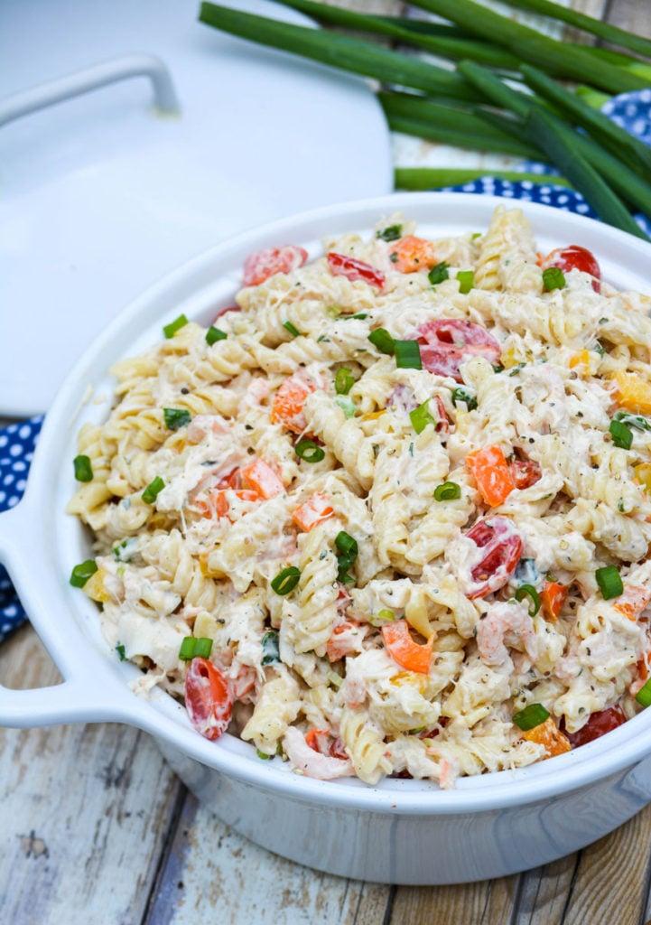 creamy seafood pasta salad in a white ceramic bowl