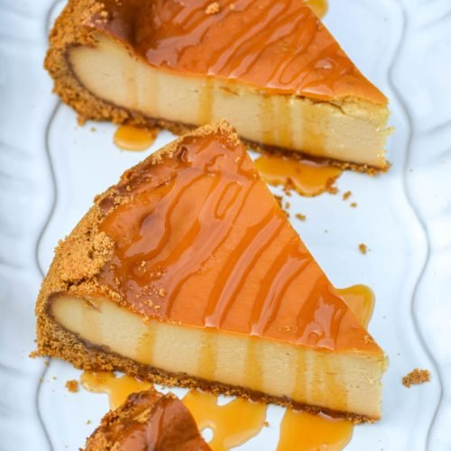 three pieces of caramel drizzled smoked cheesecake on a white platter