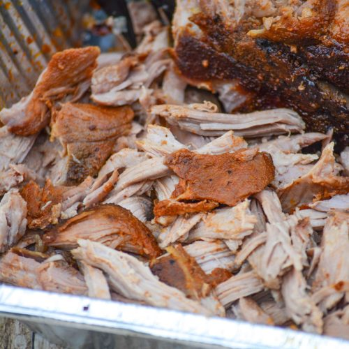 smoked pulled pork shown in an aluminum tray