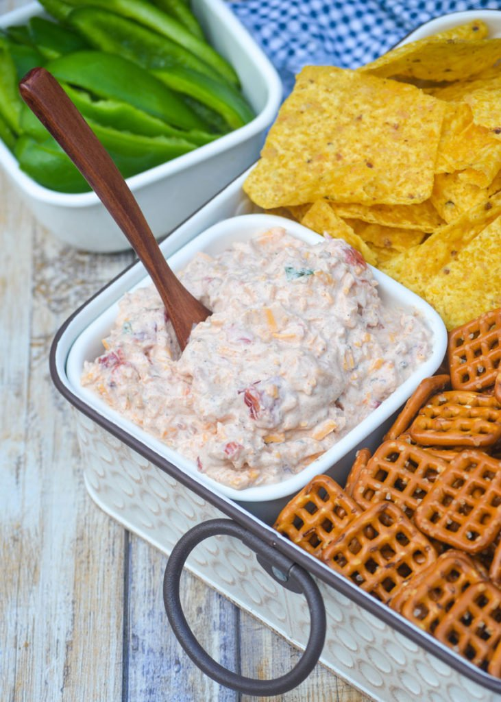 tiktok boat dip in a white bowl with a small wooden spoon stuck in the dip