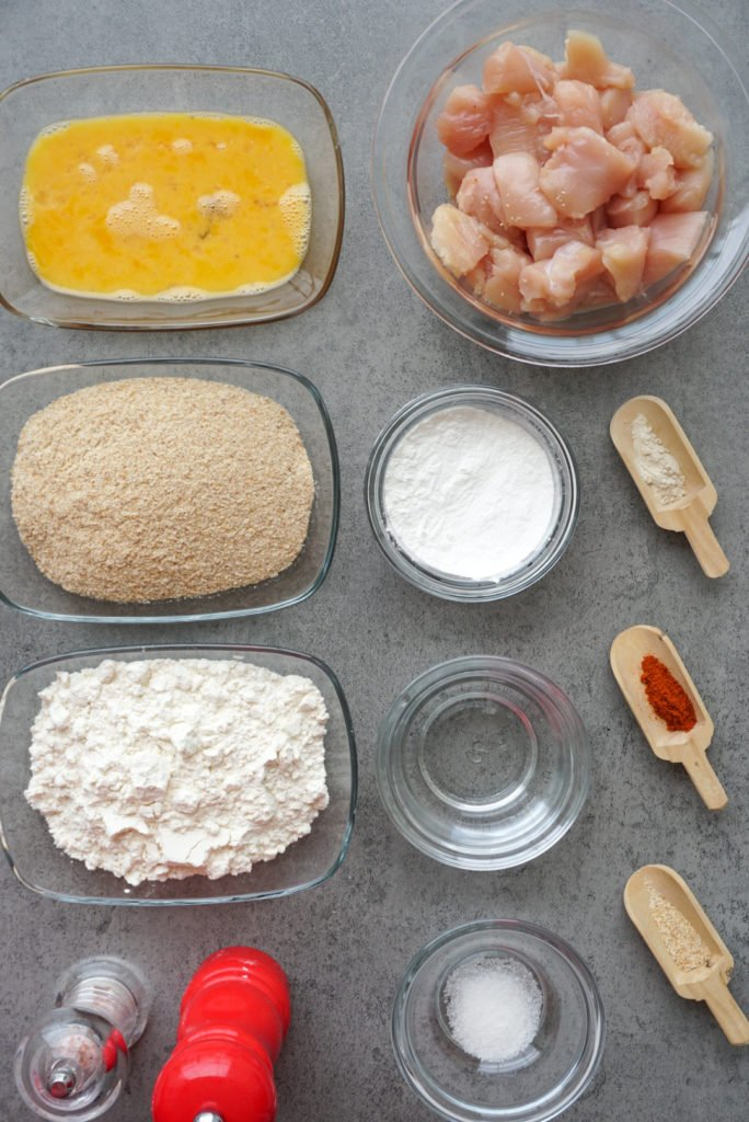 an overhead shot showing all of the ingredients needed to make a batch of chicken nuggets