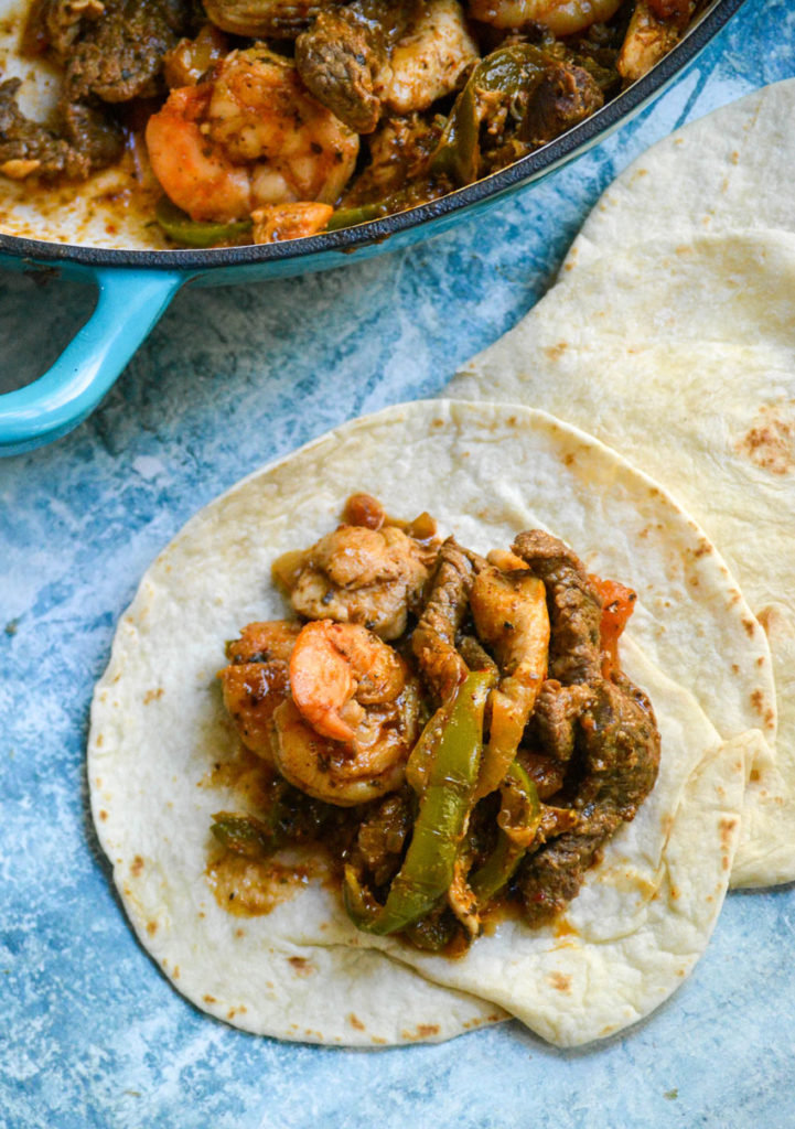 steak, chicken & shrimp fajita filling piled on a soft flour tortilla