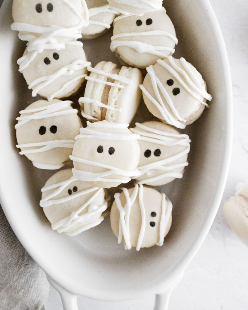 mummy macarons in a white oval serving dish