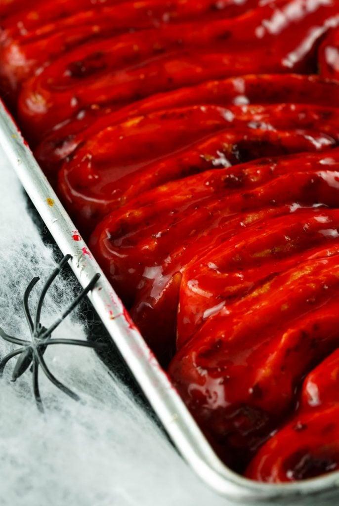 blood & guts cinnamon rolls in a rimmed silver baking tray